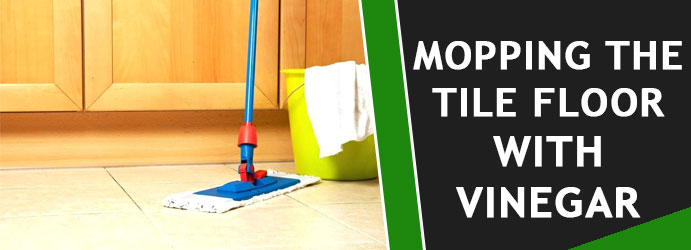 Mopping the tile floor with vinegar